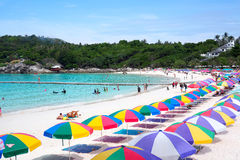 Beach umbrellas on white beach in thailand Royalty Free Stock Images