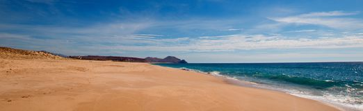 Beach under cirrus cloudscape at the Todos Santos artist community in central Baja California Mexico. BCS Royalty Free Stock Image
