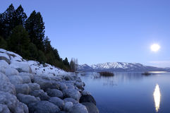 Beach Under The Moon - Lake Tahoe In Winter (Bluish Version). Moonlit lake Tahoe beach in winter - original bluish WB. Shot just before dawn Royalty Free Stock Photography