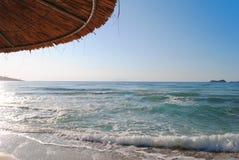 Beach. Under A Beach Umbrella. Sea & sky Royalty Free Stock Photography