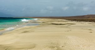 Beach on uninhabited cape verde island cabo verde, Santa Luzia. Strong winds and overcast sky. Stock Image