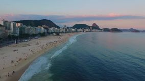 The beach and the urban area of Copacabana at sunset. Shevelev. The beach and the urban area of Copacabana at sunset. Panorama of Copacabana beach and stock video footage