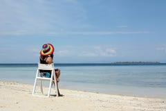 Beach vacation. Portrait of woman sitting an beach Royalty Free Stock Photos