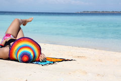 Beach vacation. Portrait of woman lie down on beach Stock Photography