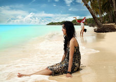 Beach vacation. Portrait of happy female vacation at beach stock photography