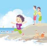 Beach vacation. A boy merrily play on a sandy beach Stock Photography