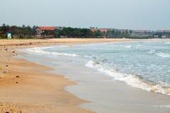 Beach vacation accessories. Beach on the Indian Ocean island of Sri Lanka. Coast Pasikudah Stock Photos
