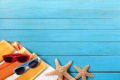 Beach vacation background, sunglasses, couple sunbathing, copy space Royalty Free Stock Photos