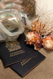 Beach vacation concept. Close-Up of passport, diving mask, sand dollar (Echinoderm), coral , conch shells, and abalone:  Beach Vacation Concept Stock Image