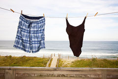 Beach Vacation Concept, Swim Suits on Clothes Line Stock Photography