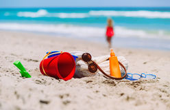 Beach vacation concept - bag, sun cream, toys and flip flops at coast Stock Photo
