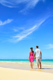 Beach vacation couple relaxing on summer holidays Stock Images