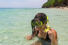 Beach vacation fun woman wearing a snorkel scuba mask making a goofy face while swimming in ocean water. Closeup. Portrait of Asian girl on her travel holidays royalty free stock images