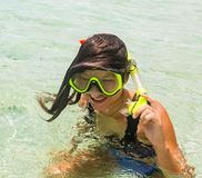 Beach vacation fun woman wearing a snorkel scuba mask making a goofy face while swimming in ocean water. Closeup. Portrait of Asian girl on her travel holidays stock photo