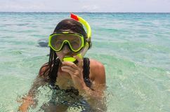 Beach vacation fun woman wearing a snorkel scuba mask making a goofy face while swimming in ocean water. Closeup. Portrait of Asian girl on her travel holidays stock images