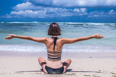 Beach vacation. Happy woman enjoying sunny day at the beach. Open arms, freedom, happiness and bliss. Tropical concept Royalty Free Stock Photo