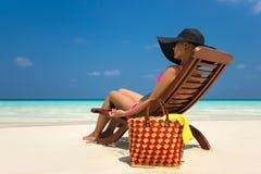 Beach vacation. Hot beautiful woman enjoying looking view of bea Stock Images