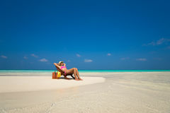 Beach vacation. Hot beautiful woman enjoying looking view of beach.  royalty free stock image