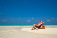 Beach vacation. Hot beautiful woman enjoying looking view of bea Stock Photography
