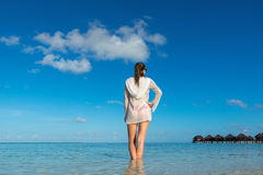 Beach vacation. Hot beautiful woman enjoying looking view of bea stock image