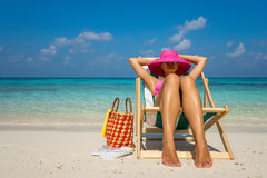 Beach vacation. Hot beautiful woman enjoying looking view of beach.  royalty free stock photos