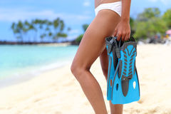 Beach vacation legs woman with snorkel flippers Stock Photo