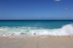 Beach, vacation, sea and waves. Sandy beach in the Caribbean with sea, blue sky, clouds and waves royalty free stock images