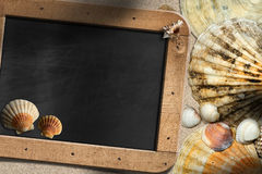 Beach Vacation - Seashells and Blackboard stock photos