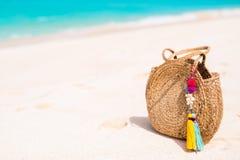 Beach vacation. Straw bag close up on tropical beach vacation royalty free stock photos
