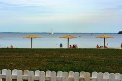 Beach vacation. Straw umbrellas on the coast. royalty free stock photography
