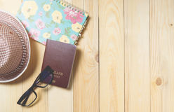 Beach Vacation travel items on wooden background. Stock Image