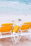 Beach vacations chairs. Beach cancun chairs in front of the sea Royalty Free Stock Photography