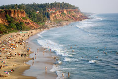 The beach in Varkala. People gather on the beach in Varkala, India, below the cliff Stock Images