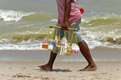 Beach vendor at the coast to sell sunscreen. Brazil: Typical image on the beaches of northeastern Brazil, beach vendors who sell sunscreen. Their merchandise Stock Photo