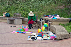 Beach vendor on the promenade near the the Millennium Pier and lighthouse in Umhlanga Rocks Stock Photos