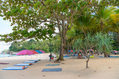 Beach vendors sell beach beds, parasols and drinks Royalty Free Stock Image