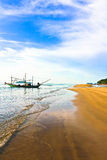 Beach view. Beach landscape view with fishing boat, mountain and sky Stock Photography