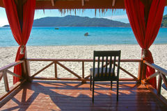 Beach view. Chair on deck in front of ocean Stock Photo