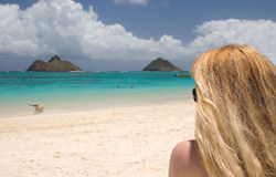 Beach View. Young woman staring at two islands off in the distance Royalty Free Stock Photo