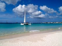 Beach view. White sand beach, turquoise sea and blue sky Stock Image