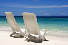 Beach View. Two beach chairs on a clean, sunny beach. Maldives stock images