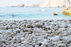 Beach view background with beautiful white rocks stock image