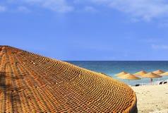 Beach view behind umbrella Stock Photos
