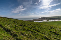 Beach view. Blue sky and green grass fields at seven sisters national park Stock Images