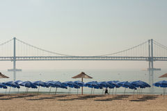 Silent Beach view with bridge. A view of tranquil and calm beach and huge bridge in the morning Royalty Free Stock Photo