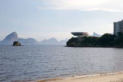 Beach view on Contemporary Art Museum Niteroi with Christ Statue and Sugar Loaf Royalty Free Stock Images