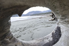 Beach view through drift wood hole,Port Renfrew Stock Photo
