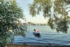 Beach view in Fethiye, Turkey, Beautiful beach scene and fishing boat Royalty Free Stock Images