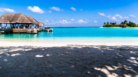 Beach view at Four Seasons Resort Maldives at Kuda Huraa Royalty Free Stock Photos