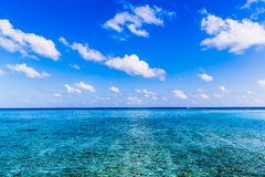 Beach view at Four Seasons Resort Maldives at Kuda Huraa Royalty Free Stock Images